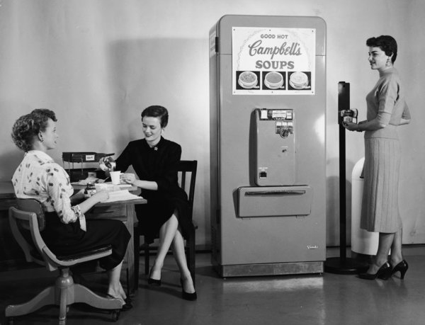 Women Use Soup Vending Machine At Work